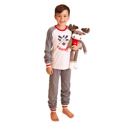 Boy with stuffed sock moose wearing matching family pajamas.  PJs for kids, dolls and dog bandana.