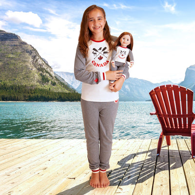 18 inch doll and girl in matching Canadian pajamas.  PJs for the whole family are available.