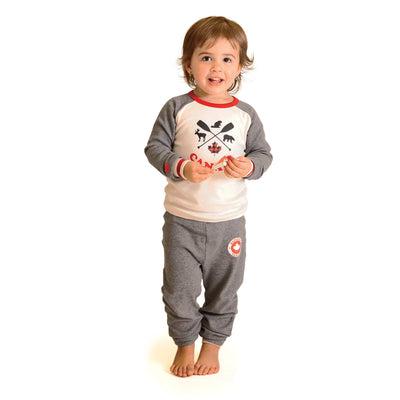 Toddler wearing Canadian pajamas that match the family, 18 inch doll and dog bandana