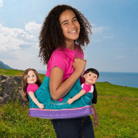 Girl with Maplelea Doll Tote carrying two 18 inch dolls.