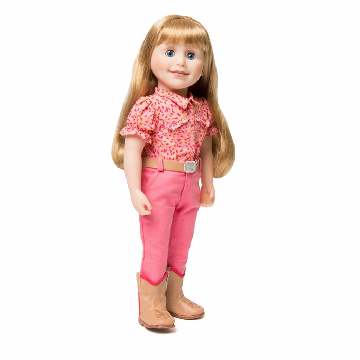 Maplelea 18 inch doll Brianne with story journal wearing pink patterned button-up shirt, pink pants, beige belt with sparkly buckle and beige riding boots.