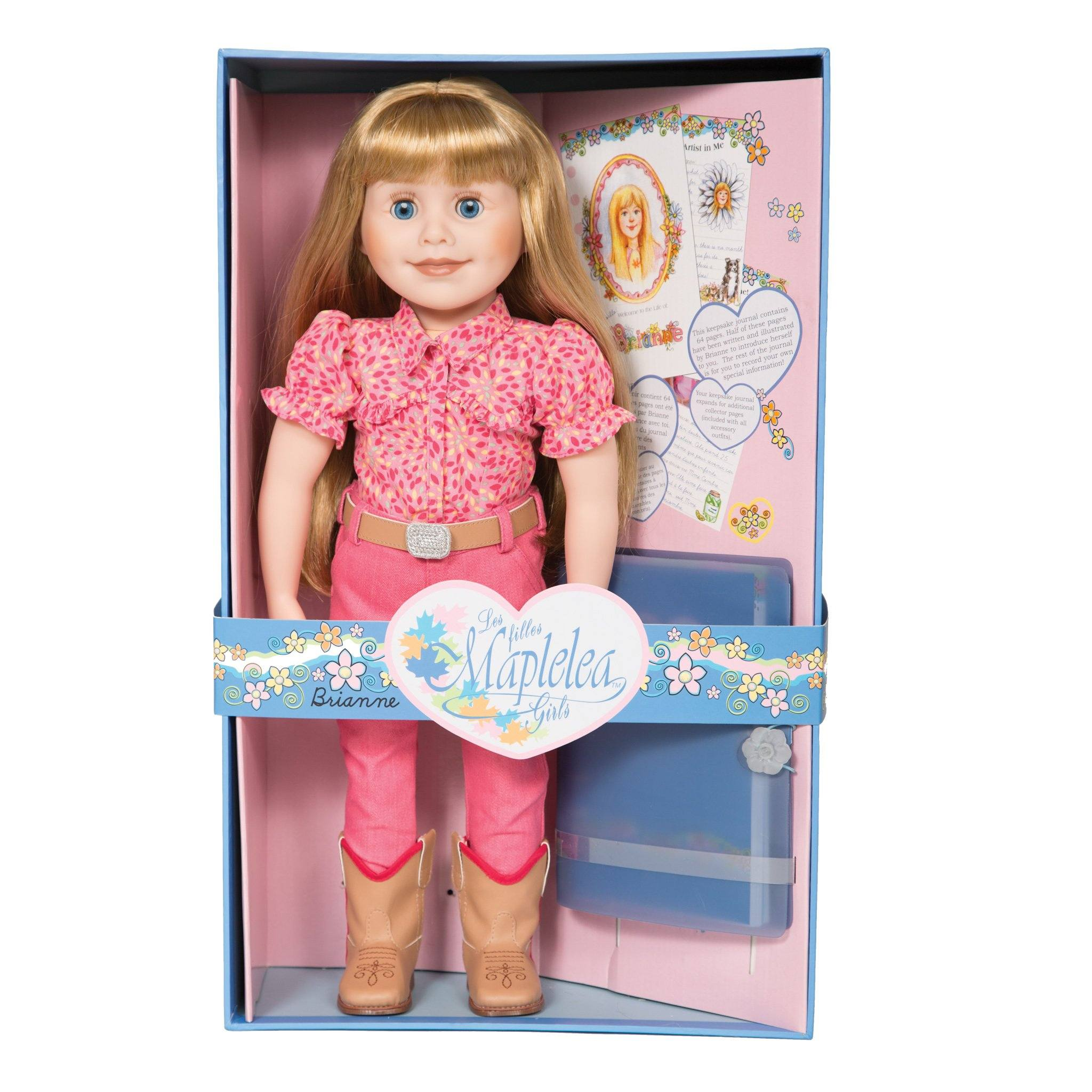 Maplelea 18 inch doll Brianne with story journal wearing pink patterned button-up shirt, pink pants, beige belt with sparkly buckle and beige riding boots.  Shown in box.