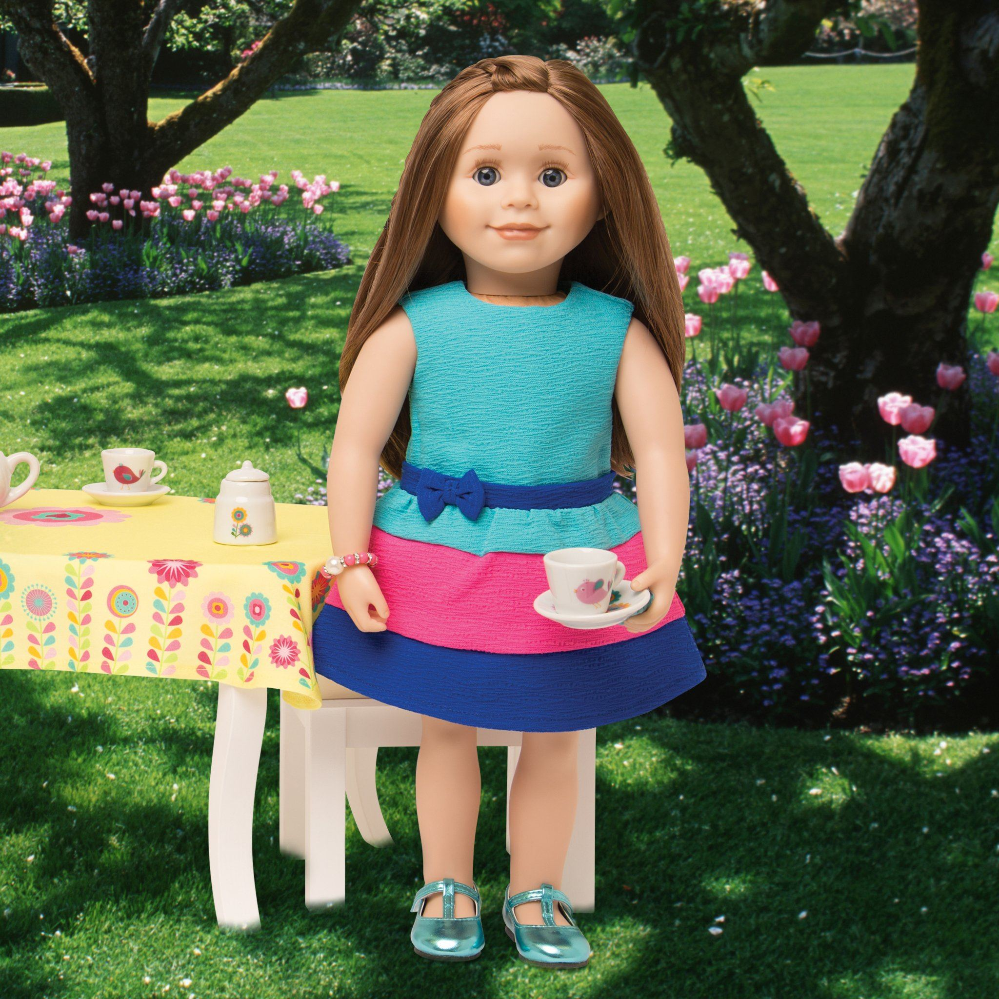 Summer dress, bracelet and blue shoes worn by 18 inch doll at a tea party.