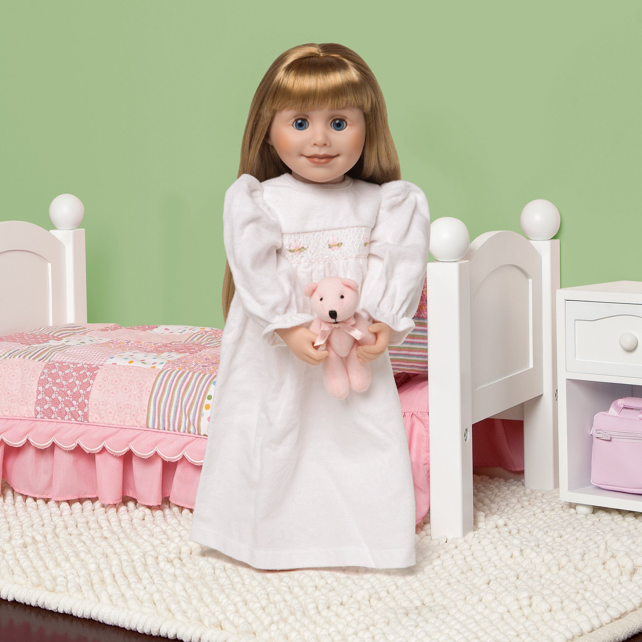 White flannel nightgown with pink teddy bear shown on 18 inch doll Brianne with Maplelea bedding.