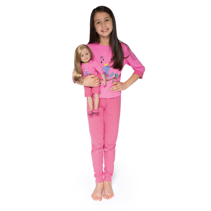 26b734540b A girl wearing pink Nightingale Nightwear pajamas holding an 18 inch doll  with matching PJs.