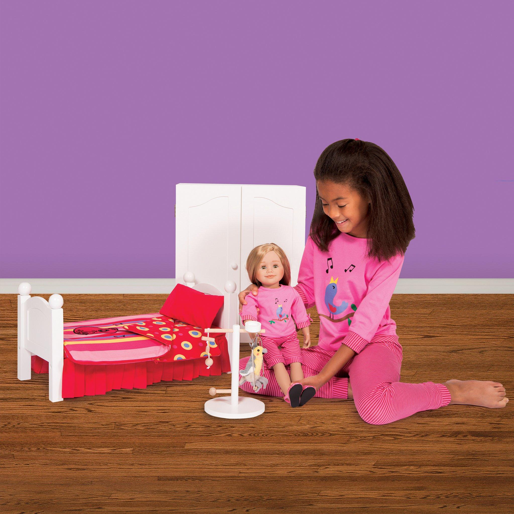 Pink Nightengale Nightwear PJs on girl with 18 inch doll wearing matching pajamas from Maplelea.