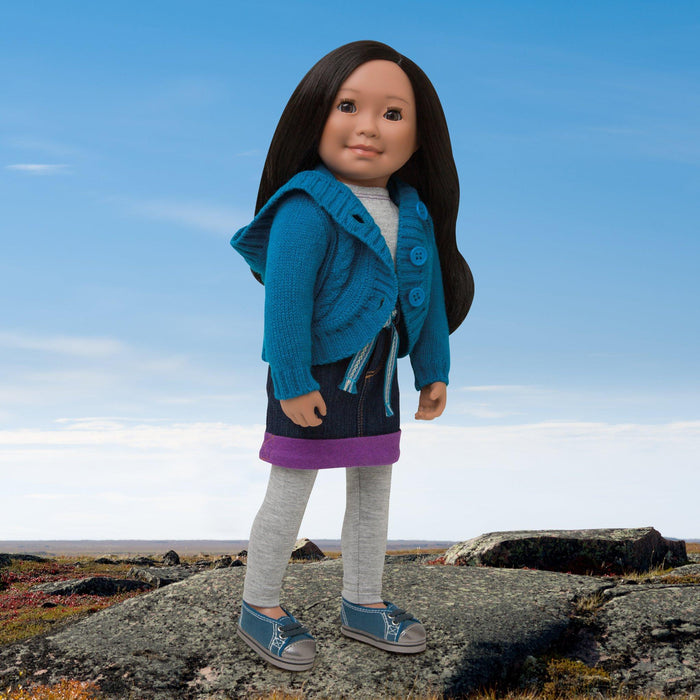 Nunavut Now blue hooded knit sweater with buttons, denim skirt with blue tie-belt and purple hem, grey leggings, grey long-sleeve t-shirt, and blue shoes with laces and silver toes fits all 18 inch dolls.
