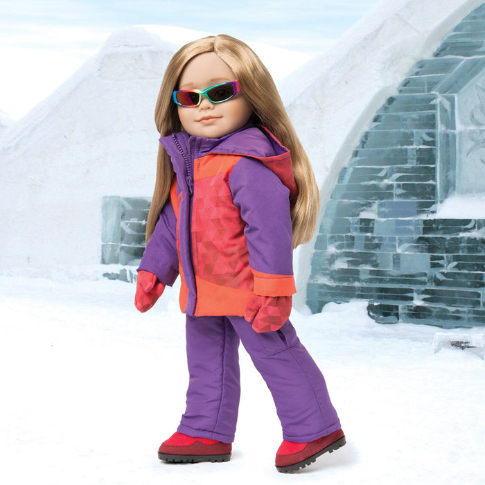 Palais Glacial red purple geometric print jacket with purple snow pants, red mitts, red winter boots and multi-colour sunglasses fit all 18 inch dolls.
