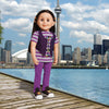 Positively Peaceful casual outfit purple pants, striped purple and grey top with peace sign floral graphic, purple embroidered vest, and black runners with mis-matched laces. Fits all 18 inch dolls.