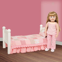 Quilted pink comforter pillow, mattress with dust ruffle on Maplelea doll bed with 18 inch doll