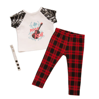 Rockin' Couture black and red plaid pants, white rock n' roll graphic t-shirt with sequin sleeves, and button wrist band fits all 18 inch dolls.