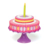 Set to Celebrate plastic cake with cake topper and candle, shown with all slices together, for all 18 inch dolls.