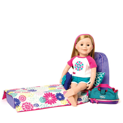 18 inch doll in pajamas on fold out bed