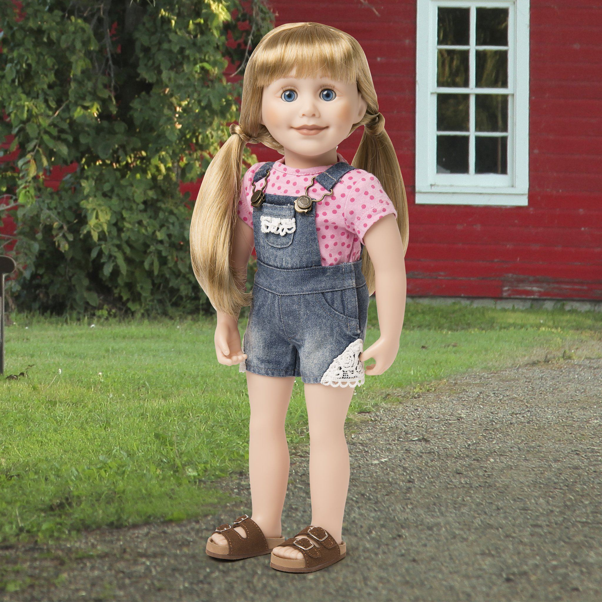 "Summer denim overall shorts with lace trim and pink polka dot t-shirt shown on 18"" doll at a farm."