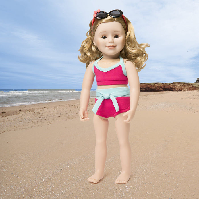 Surf's Up 2-piece bright fuchsia and light teal bathing suit, with pink and black sunglasses with flower appliqué. Fits all 18 inch dolls.