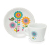 Time for Tea white ceramic tea cup and saucer with bright flower graphic.