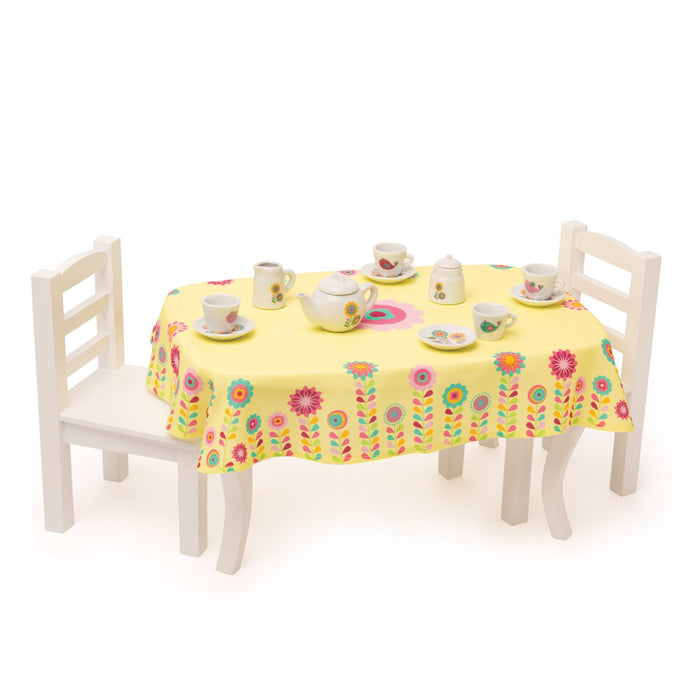 Time for Tea white ceramic set of 4 tea cups, 4 saucers, tea pot, creamer, sugar bowl and yellow table cloth with bright flower graphics adorning all items. Fits KM102 Table and Chairs set.