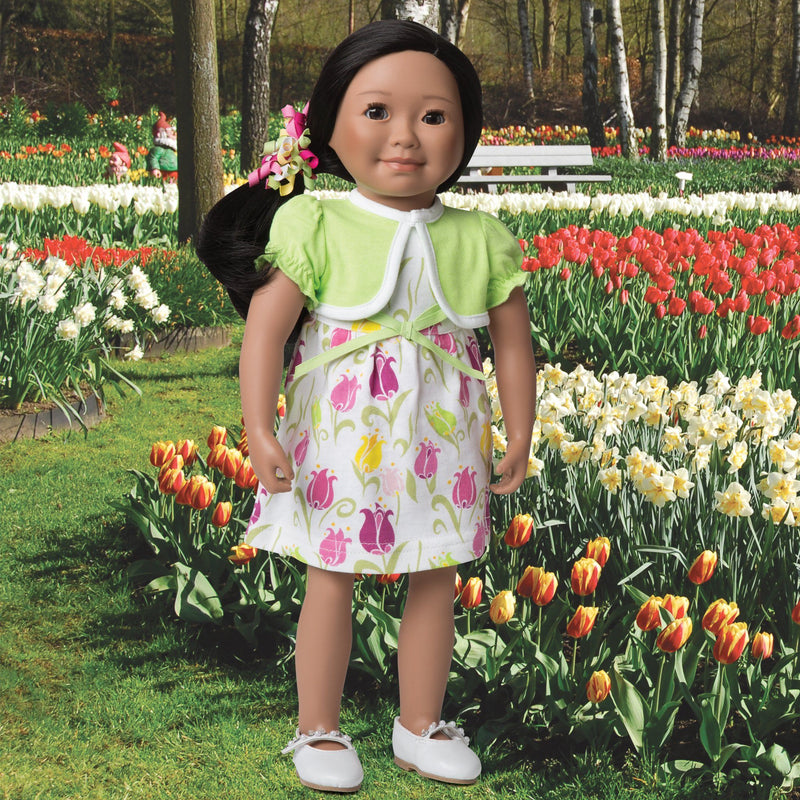 Tulip Royale white dress with pink tulip print, light green bolero jacket with white trim and colourful curly hair elastic fits all 18 inch dolls.
