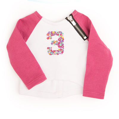 Zippity Do long sleeved athletic shirt with dark pink sleeves, zipper detail and floral number 3 graphic fits all 18 inch dolls.