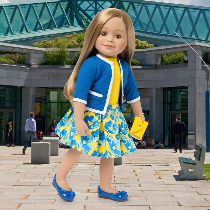 Blue jacket with white trim, yellow top, blue and yellow floral skirt, yellow wristlet and blue flats fits all 18 inch dolls. Shown on KL1 Léonie doll in front of the Musée des Beaux-Arts.