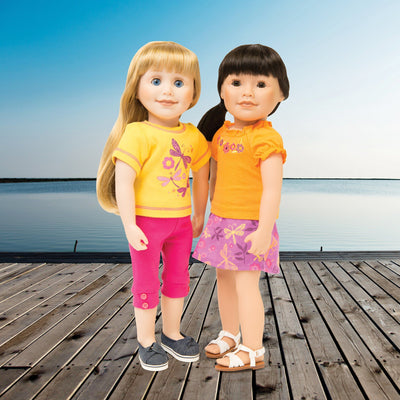 Two 18 inch dolls modelling a 4 piece summer mix and match outfit.
