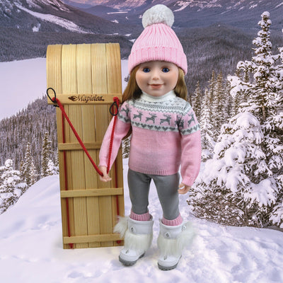 18 inch doll with toboggan and winter sweater set and furry white winter boots.