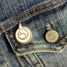 Breastfeeding enamel pin on denim jacket