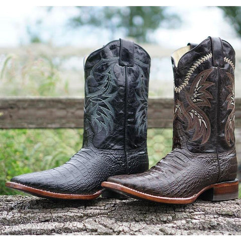 Black and Brown Caiman Belly Print Cowboy Boots in rustic setting