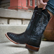 Man pulling up H4001 Caiman belly print black cowboy boots