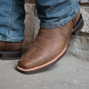 Man wearing tan square toe Mens cowboy boots H4002 with blue jeans