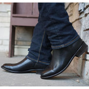 Mean wearing black premium leather roper boots with Jeans