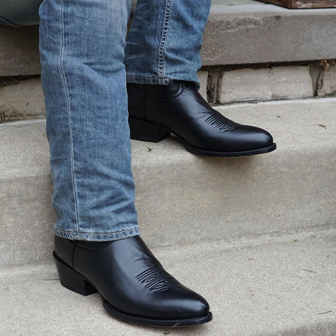 Lifestyle Shot of Men with Blue Jeans in Round Toe Cowboy Boot in black