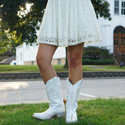 Girl in White Dress Wearing Soto Boots M50040 Wedding Cowgirl Boots in front of Church