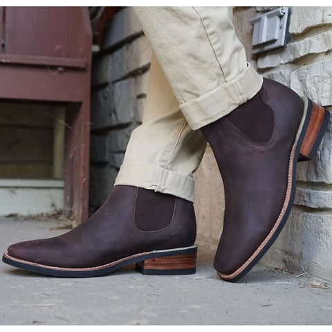 Man wearing dark brown Chelsea Ankle Boots with khaki pants