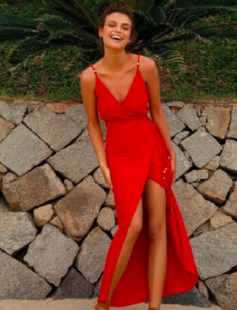 Model wearing a red Cindy dress with golden details