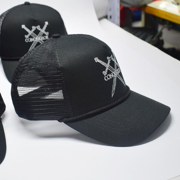Black trucker logo snapback hat