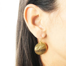 gold disc drop earrings on model