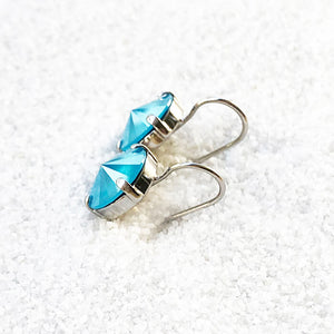 ethical silver earrings with azure blue swarovski crystal