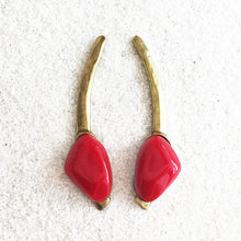 gold ethical long drop earrings with red handcast resin