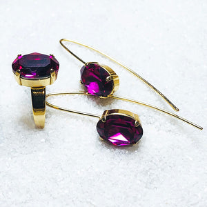 elegant gold jewellery with fuschia swarovski crystal