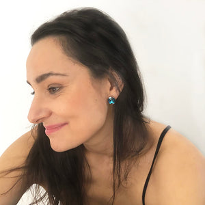 unique rhodium silver and turquoise crystal statement stud earrings on model