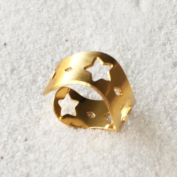 elegant adjustable ring in gold with star cutouts