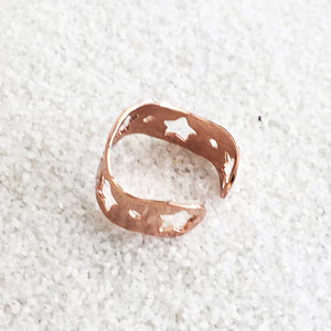 flat rose gold adjustable ring with star shaped cutouts