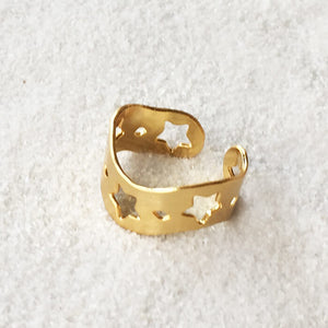 adjustable ring in gold with star cutouts