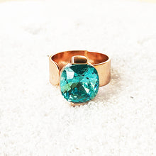 elegant rose gold statement ring with light turquoise swarovski