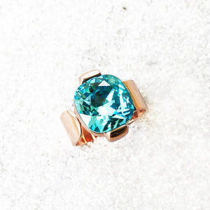 elegant statement ring rose gold and light turquoise swarovski