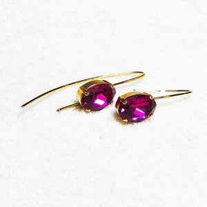 ethical gold dangle earrings with fuschia swarovski crystal