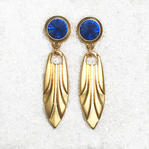 gold dangly earrings with blue stone