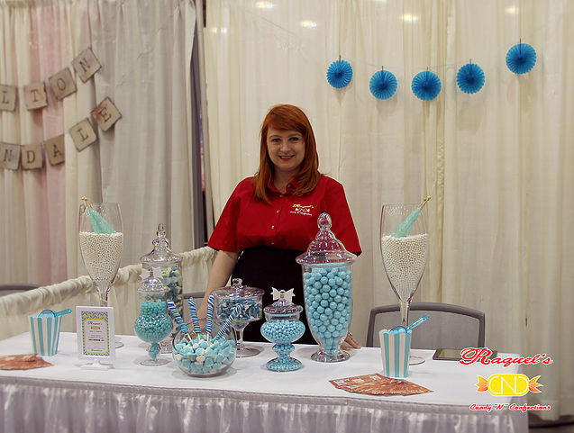 Laura standing behind desert table at Bridal Expo