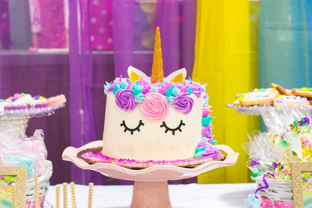 Unicorn Cake with desert table